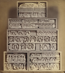 Small ornamental panels: Buddhas and minor figures under arches between pillars, from Jamal-Garhi.